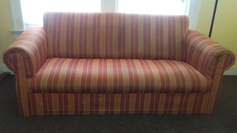 Striped sofa.  Some stains but in decent shape.